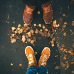 55631912 - couple man and woman feet in love romantic outdoor with autumn leaves on background lifestyle fashion concept