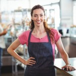 42325943 - pretty waitress leaning on counter at the bakery