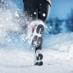 17425312 - athlete woman is running during winter training outside in cold snow weather